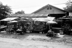 Fresh market building (QooL / بنت شمس الدين) Tags: travel bw market lucky m3 laos stalls 002 qool shd100 namlik qoolens banhinheuptai