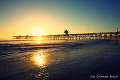 san clemente beach (Eric 5D Mark III) Tags: california sunset shadow color reflection beach silhouette gold golden pier surfer wave atmosphere flare orangecounty sanclemente tone ef1635mmf28liiusm