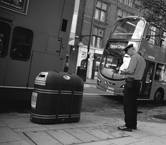 Crisis time : he  even imposes a fine to a poor and lonely bin :-) (Pierre Mallien) Tags: street uk carnival autumn wedding red england people urban bw en bus guy london fashion canon shopping fun eos photo mac aperture raw belgique britain pierre candid stage police pit bin litter oxford londres carnaval metropolis streetphoto mariage rue mode pour tous londonist streetphotographer comique britania originaliphoto rawstreet pitvanmeeffe 5dmark2 mallien pierremallien rechercheunphotographemariage stagephotobelgique walloniestage lemeilleurphotographedemariagedebelgique
