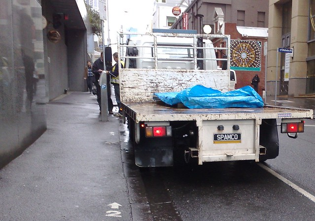 Narrow footpath, and truck with amusing number plate