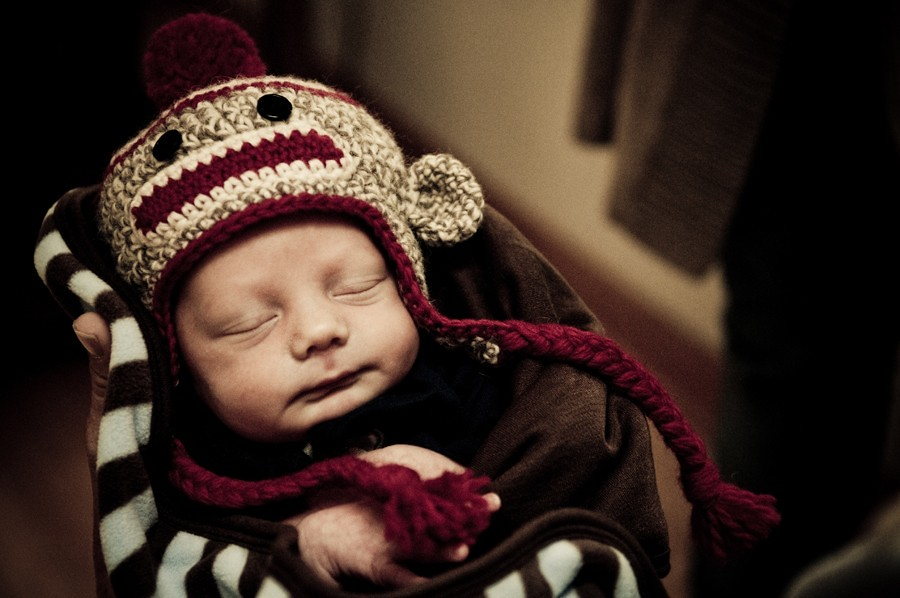Newborn Baby Boy wearing a Sock Monkey Hat