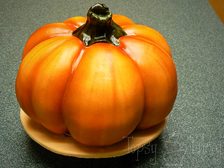 airbrushing-fondant-covered-hand-carved-pumpkin-cake