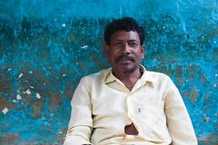 Homme au mur bleu (hubertguyon) Tags: blue portrait india man wall village tribal bleu mali tribe mur orissa homme inde tribu mywinners earthasia