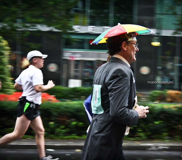 running umbrella man