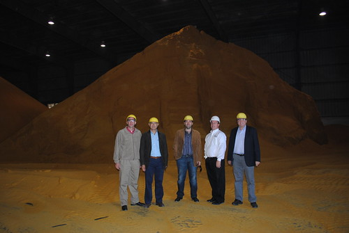 The Trade Team in front of a DDGS mountain