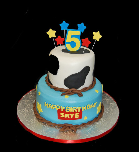 5th Birthday Cow print and stars 2 tiered cake for a Toy Story themed celebration