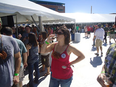 hot girl drinking cold beer at beer festival
