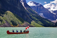 Canadian Canoe (Jim Boud) Tags: travel blue red mountain lake canada mountains reflection green nature water pinetree canon lens landscape outdoors eos gold boat is nationalpark colorful paradise peace hill smooth relaxing rocky floating peaceful wideangle canadian canoe glacier shore alberta valley boating northamerica banff usm canoeing dslr lakelouise 1785mm digitalrebel relaxed photoart digitalslr pinetrees efs1785mmf456isusm province firtree waterscape artisticphotography canadianrockies glacialvalley imagestabilization imagestabilized 550d jimboud t2i exposurefusion jamesboud eos550d kissx4