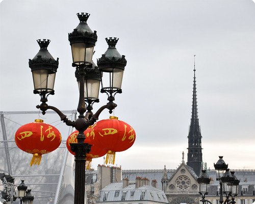 Red lanterns face to Notre Dame