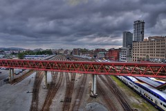 The End of the Road: Vancouver B.C (Brandon Godfrey) Tags: pictures city railroad light urban canada vancouver clouds train buildings dark photography downtown day cityscape bc waterfront pacific metro cloudy photos pics britishcolumbia sony transport tracks railway overcast trains canadian transportation western pacificnorthwest northamerica metropolis dslr gastown dappled hdr highdynamicrange choochoo gangway woolworthbuilding lowermainland a300 photomatix tonemapped tonemapping