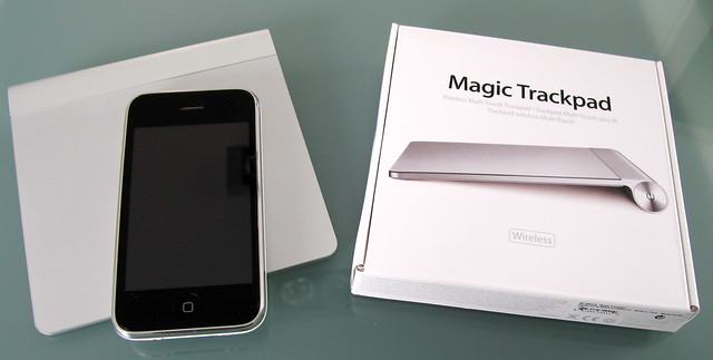 Magic Trackpad with iPhone and packaging