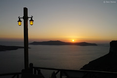 Sunset in Santorini (Ben Heine) Tags: voyage trip travel sunset wallpaper seascape mountains hot lamp relax island fire photography gold freedom golden evening solar seaside holidays warm heaven waves glow view illumination naturallight poetic enjoy simplicity tropical romantic imaging unreal quite sunrays simple zon feu backlighting coucherdesoleil lampadaire rayons vibration waterscape rverie horizons artificiallight ignite le chaleur aegeansea theartistery merege magicevening creativecomposition sunsetinsantorini energyaura flickrunited enflame samsungnx10 benheinecom geologicalcaldera