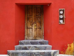 you missed a spot (msdonnalee) Tags: door red rot mxico stairs facade mexico rouge rojo puerta steps entrance stairway vermelho treppe escalera doorway porta mexique scala porte portal escada redwall rosso fachada escalier entry treppen messico  rd  escala  punainen  woodendoor wooddoor  utilitymeter    i weathereddoor    photosfromsanmigueldeallende brownwooddoor tripleniceshot fotosdesanmigueldeallende flagstonestairs
