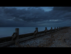 Storm (Simon Rich Photography) Tags: uk sea sky beach clouds canon dark evening coast moody stones norfolk stormy east coastline defence runton eos5d simonrich mrmonts simonrichphotography