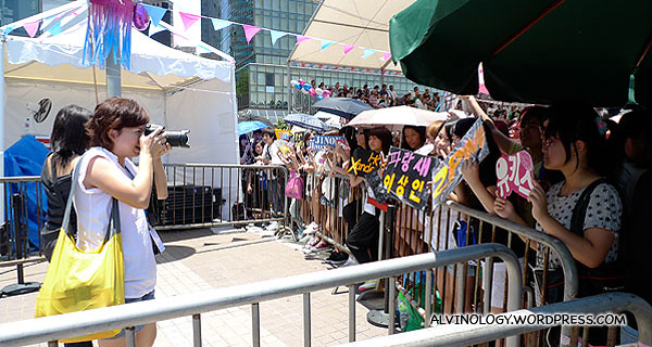 Evil Gin taking pictures of envious teenage fans who also wants to be in the VIP/media area