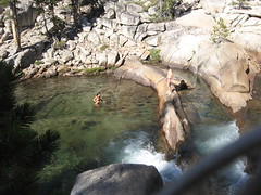 Couple swims at falls west end of Tuolumne Meadows 9-5-10 (Bob_ Perry) Tags: sierra yosemite yosemitenationalpark tuolumne tuolumnemeadows tuolumneriver california120 sierrawaterfall tuolumnefalls potholedomefalls
