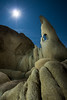 The Moon, the Sky, and the Wizard's Eye - Joshua Tree National Park (Jim Patterson Photography) Tags: pictures california longexposure travel blue light portrait sky usa moon white lightpainting color nature yellow vertical night stars landscape gold golden nationalpark twilight rocks desert natural photos tripod scenic rocky wideangle landmark boulders granite gitzo reallyrightstuff joshuatreenationalpark moonburst tokina1017mm pintowye nikond300 markinsm20ballhead jimpattersonphotography jimpattersonphotographycom seatosummitworkshops seatosummitworkshopscom