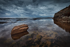 Narrabeen Reflections (Xenedis) Tags: ocean sky seascape reflection water rock clouds sunrise dawn australia boulder nsw newsouthwales narrabeen