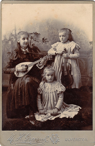Girls with musical instruments. Ulverston, Cumbria.