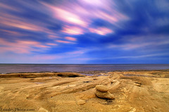 Rush Clouds (A.alFoudry) Tags: blue sea storm beach clouds speed sunrise canon eos rocks long exposure slow purple mark full rush frame shutter 5d kuwait fullframe heavy ef kuwaiti q8 abdullah  mark2 1635mm   || kuw q80 q8city xnuzha alfoudry  abdullahalfoudry foudryphotocom mark|| 5d|| canoneos5d|| mk|| canoneos5dmark|| canonef1635mmf28l|| f28l||