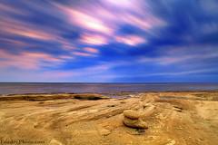 Rush Clouds (A.alFoudry) Tags: blue sea storm beach clouds speed sunrise canon eos rocks long exposure slow purple mark full rush frame shutter 5d kuwait fullframe heavy ef kuwaiti q8 abdullah عبدالله mark2 1635mm الكويت كويت || kuw q80 q8city xnuzha alfoudry الفودري abdullahalfoudry foudryphotocom mark|| 5d|| canoneos5d|| mk|| canoneos5dmark|| canonef1635mmf28l|| f28l||