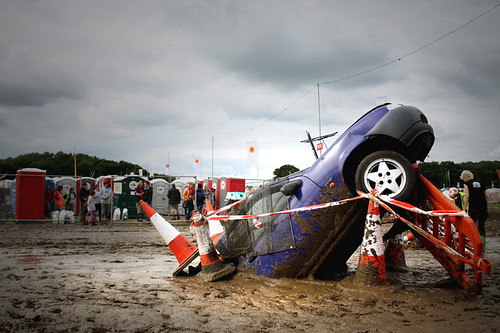 car in mud pit photo