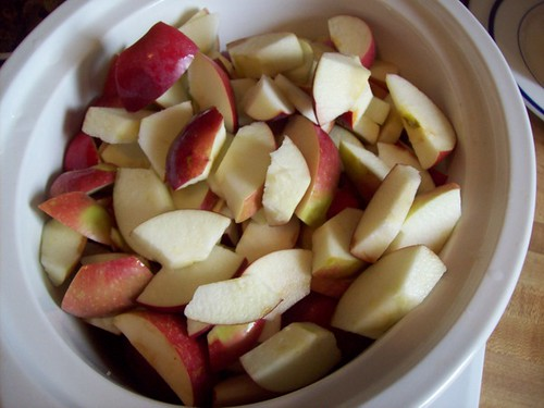 Sliced apples in the crockpot for apple butter
