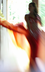 Fire (Gordana AM) Tags: red music orange woman baby ontario canada painterly motion blur girl statue vertical tangerine backlight lensbaby lens fire person one dance veil dancing curves bellydancer dancer tango flame exotic windsor oriental lm sway rhythm composer tantan statuesque sooc class2010 lepiafgeo happybirthdaylensbaby