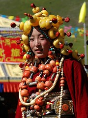 wow! strong girl - massive headdress and beadery (BetterWorld2010) Tags: tibetans coral festival gold amber necklace beads costume treasure dress jewelry tibet ring celebration bracelet amdo kham sichuan traditionalcostume 2009 litang headdress robes yushu  tibetanwoman    khampa golok lithang tibetangirl tribalcostume tibetanfestival  tibetanwomen