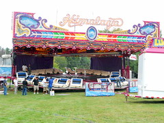 Himilaya (trumpeterny) Tags: show new york carnival autumn food ny newyork game travelling fall apple up festival set truck square fun amusement ride central harvest down fair rack rides setup chance trailer tear midway slough centralsquare amusements utica inflatables inflate teardown racked