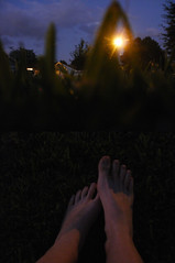 Saying goodbye to summer nights (ShannonMichelle416) Tags: city trees houses sunset summer sky orange house tree green feet grass yellow night clouds yard dark photography lights backyard streetlight toes bright florida bokeh streetlamp lawn nighttime