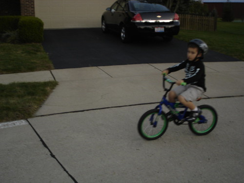 Mason riding his two wheeler