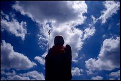 (troutfactory) Tags: sky film silhouette statue japan clouds 35mm voigtlander bessa rangefinder slide figure  osaka analogue  kansai   jizo guardian protector  toyonaka ultron kodak100  r2a colorreversal