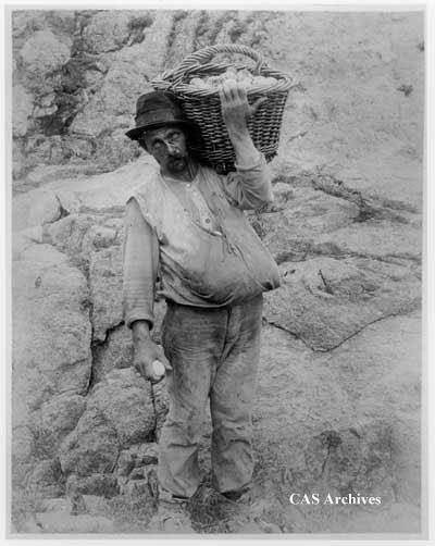 """Scottie 'the Egger', South Farallon Islands, July '96."" Man holding basket on his shoulder."