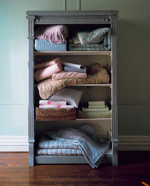 Sang An Photography.com Cozy Quilted Blankets on vintage book shelve