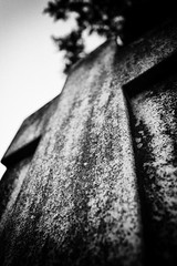 Still I Rise with a Farewell (SocialMediaByte) Tags: light shadow urban blackandwhite bw abstract motion black blur reflection art monochrome cemetery silhouette stone composition contrast focus media cross artistic metro curves tomb tombstone perspective shapes angles dramatic highcontrast naturallight poetic sharp explore mysterious tone atmospheric cultural bold illuminate luminescent luminosity harmonious visualconcept