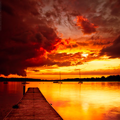 Magma (Marc Benslahdine) Tags: longexposure sunset red orange lake france hot reflection colors yellow jaune sunrise landscape rouge gold golden soleil boat dock mood or explosion lac explore burning ciel burn saturation fusion nuages bateau paysage reflexion franais eruption magma ponton coucherdesoleil barque lave feux lightroom etang chaleur hotshot longexp longexposition traitement poselongue dore 16sec tamronspaf1750mmf28xrdiii vairessurmarne canoneos50d marcopix lightroom3 basedeloisirs tripax marcbenslahdine wwwmarcopixcom wwwfacebookcommarcopix gettyimagesfranceq1 marcopixcom