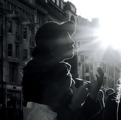 Light conversation (Ian Brumpton) Tags: street blackandwhite bw blancoynegro blackwhite noiretblanc candid londres picadillycircus citystreets contrejour intothesun lightconversation sidewalkstories londonstreetphotography lifeinslowmotion ianbrumpton aimlessstrolling conversationwithlight