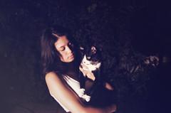 x  (reptiLens) Tags: dog love girl night cat canon dark outside holding kitten friendship kitty tuxedo meow embrace hold catdog canon50d