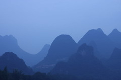 Blue sweet hills (deus77 [busy]) Tags: china morning cruise blue panorama mist mountain fog river landscape liriver scenery guilin yangshuo scenic spot hills layers  peaks  karst lijiang  guangxi  topography hillsides flickraward platinumheartaward flickraward5 flickrawardgallery