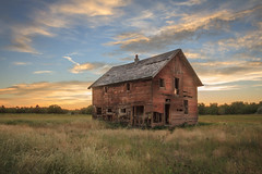 Homestead (http://fineartamerica.com/profiles/robert-bales.ht) Tags: barn buildings forupload gemcounty haybales idaho old people photo places projects states sunrise sunset house farm homestead ranch cattle barnwood fence butte squawbutte mountain idado landscape emmett treasurevalley scenicbiway americaphotography valley idahophotography beautiful sensational spectacular awesome magnificent peaceful surreal sublime magical spiritual inspiring inspirational canonshooter scenic wow stupendous superb building grass hay trees yellow blue robertbales sky