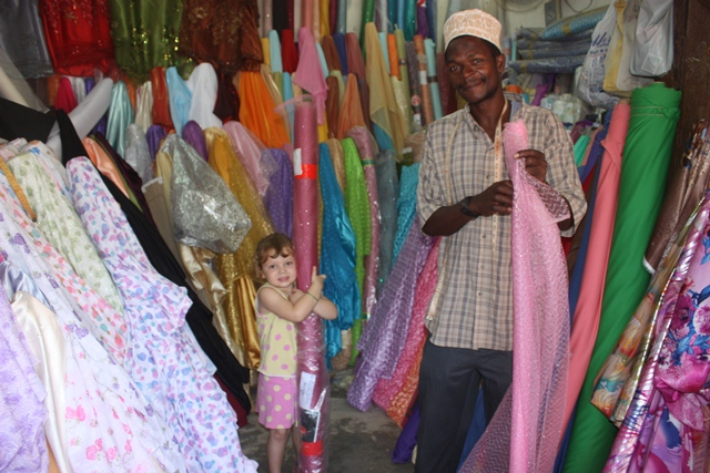 anni and Evy, anni buying fabric in mjini 006.jpgedit