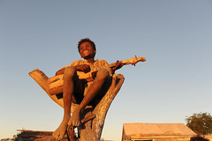 happiness! (explore) (luca.gargano) Tags: world voyage africa boy sunset playing smile child play singing guitar happiness sing madagascar gargano lucagargano tanalana