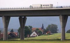 Two worlds (:Linda:) Tags: bridge church truck germany highway village kirche autobahn thuringia viaduct pylon spire brcke highwaybridge schiefer viadukt autobahnbrcke brnn slateshingle slateshingled brnntalbrcke schiefergedeckt