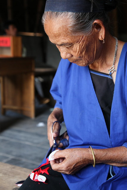 Woman making craft work in Chengyang, Guangxi, China
