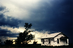 Texas Storm 1 (tobysx70) Tags: nikon f2 photomic slr camera kodak ektachrome lumiere 100 professional 35mm 135 color slide film 5046 lpp crossprocessed xpro texas storm route 66 rte rt tx abandoned house cabin home onimous dark clouds cloudporn tree silhouette toby hancock photography