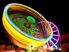 Tilt-a-Whirl (~Abby) Tags: longexposure carnival wheel night dark lights amusement michigan sony ferris nighttime amusementpark rides tiltawhirl whoa midway midlandcountyfair sonyh50