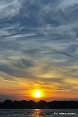 Sunset over New Jersey (Rafakoy) Tags: city sunset sky cloud sun ny newyork color colour reflection building water colors skyline night clouds digital buildings reflections river pier newjersey nikon marine cityscape colours dusk piers nj hudson nikkor hoboken nikond90 afsnikkor18105mmvr aldorafaelaltamirano rafaelaltamirano aldoraltamirano