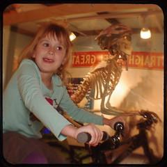 Lucy and the skeleton (Area Bridges) Tags: bike bicycle skeleton march lucy pentax kodak norwalk connecticut steppingstones duaflex 2010 duaflexiv kodakduaflexiv ttv throughtheviewfinder k200d march2010 areabridges