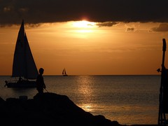 Florida-evening on the jetty (ashabot) Tags: ocean sunset people orange gulfofmexico boats evening sailing florida jetty beaches sailboats